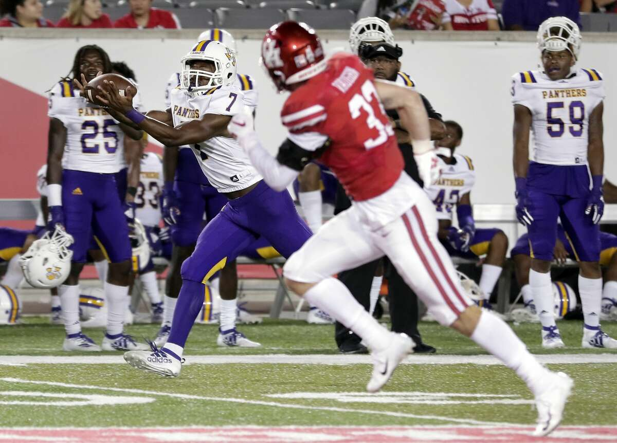 Prairie View A&M running back Kristian Mosley (7) makes the reception for a touchdown in front of Houston safety Garrison Vaughn (33) during the second half of an NCAA college football game Saturday, Sept. 7, 2019, in Houston, Texas.