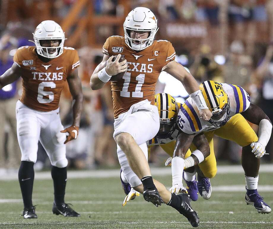 Longhorn quarterback Sam Ehlinger takes the bal into the open field for a long gain in the second half as Texas hosts LSU at Darrell K. Royal Stadium on September 7, 2019. Photo: Tom Reel, Staff Photographer