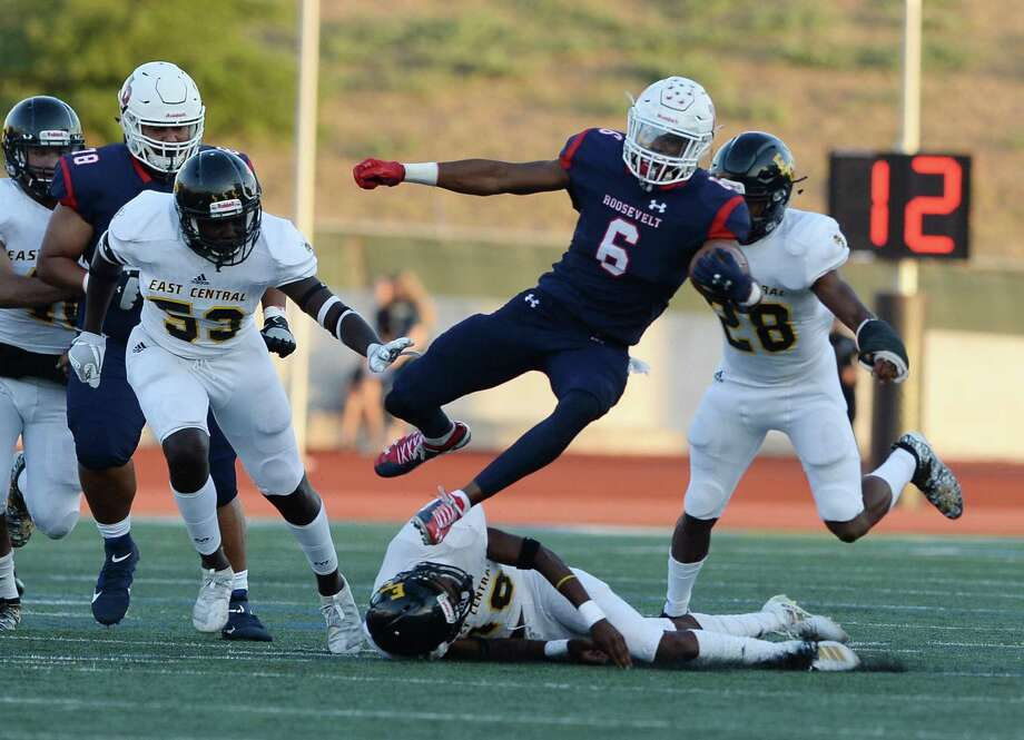 Roosevelt wide receiver Rashod Owens leaps over East Central James Gentry in the second quarter during a Class 6A, Div. II football game at Heroes Stadium on Saturday, Sept. 7, 2019. Photo: Carlos Javier Sanchez / Contributor / pixelreflexmedia.com