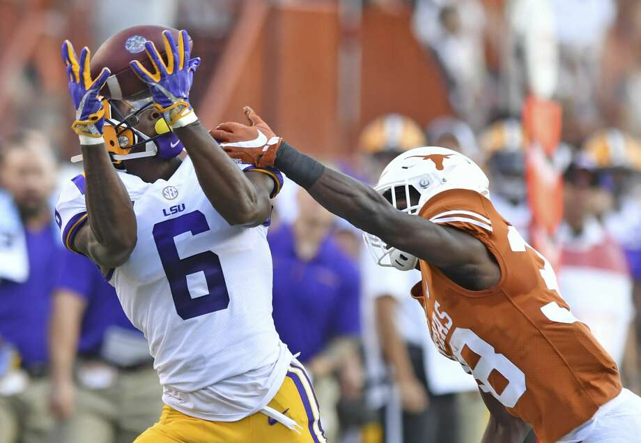 LSU wide receiver Terrace Marshall Jr. (6) pulls in a pass next to Texas defensive back Kobe Boyce (38) during an NCAA college football game Saturday, Sept. 7, 2019, in Austin, Texas. (Hilary Scheinuk/The Advocate via AP) Photo: Hilary Scheinuk/Associated Press