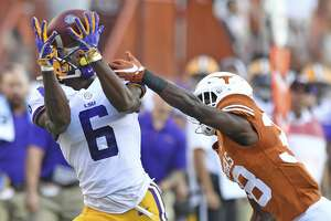 LSU wide receiver Terrace Marshall Jr. (6) pulls in a pass next to Texas defensive back Kobe Boyce (38) during an NCAA college football game Saturday, Sept. 7, 2019, in Austin, Texas. (Hilary Scheinuk/The Advocate via AP)