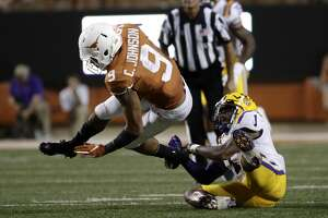 Texas wide receiver Collin Johnson (9) is tackled by LSU cornerback Kristian Fulton, right, after making a reception during the second half of an NCAA college football game Saturday, Sept. 7, 2019, in Austin, Texas. (AP Photo/Eric Gay)
