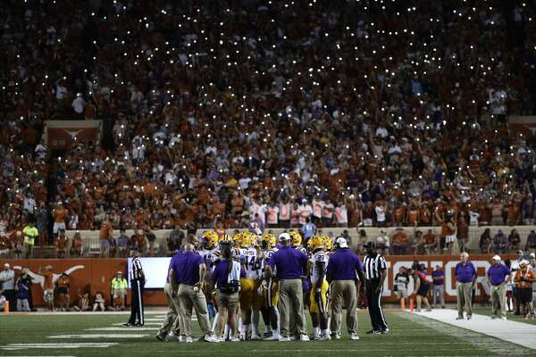 LSU players huddle on the field during the second half of an NCAA college football game against Texas, Saturday, Sept. 7, 2019, in Austin, Texas. (AP Photo/Eric Gay)
