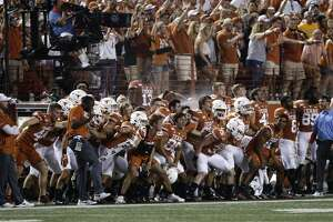 Texas players react on the sideline during the second half of an NCAA college football game against LSU, Saturday, Sept. 7, 2019, in Austin, Texas. (AP Photo/Eric Gay)