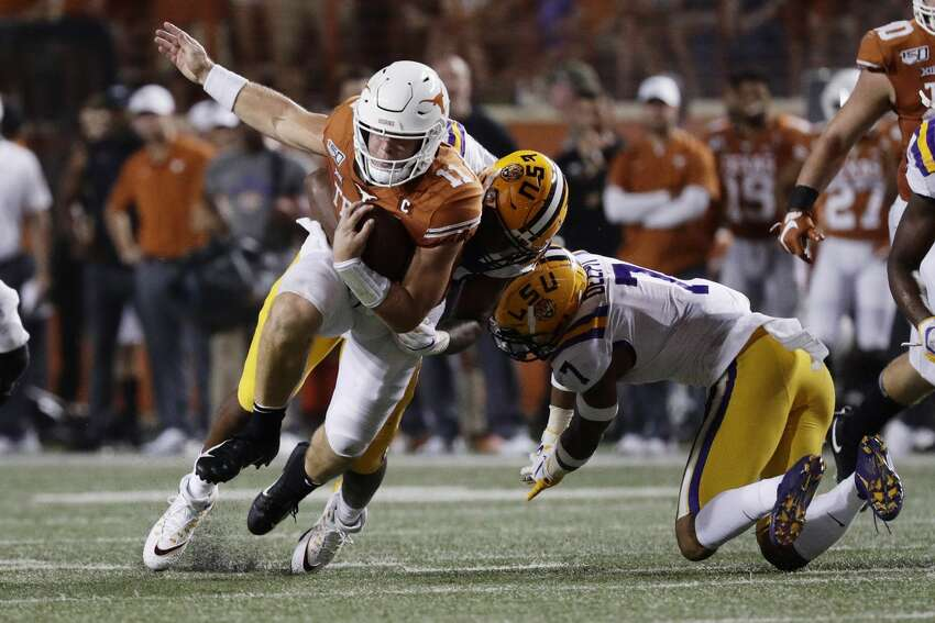 Texas quarterback Sam Ehlinger (11) is hit by LSU defensive end Justin Thomas (93) during the second half of an NCAA college football game Saturday, Sept. 7, 2019, in Austin, Texas. (AP Photo/Eric Gay)