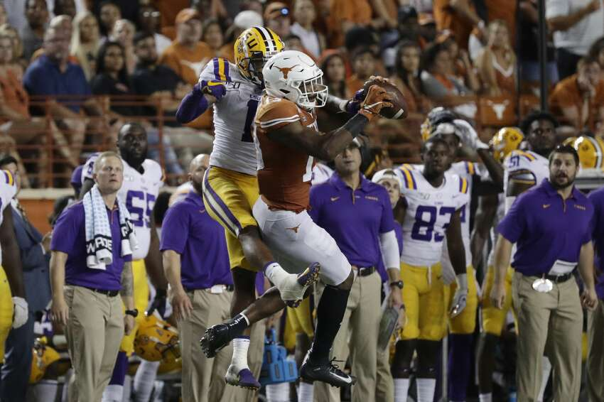Texas wide receiver Brennan Eagles (13) makes a catch in front of LSU cornerback Kristian Fulton (1) during the second half of an NCAA college football game Saturday, Sept. 7, 2019, in Austin, Texas. (AP Photo/Eric Gay)