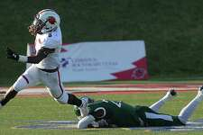Lamar's Myles Wanza evades the tackle attempt by Mississippi Valley State's Rod Sylvestre during their game Saturday at Lamar. Photo taken Saturday, September 7, 2019 Kim Brent/The Enterprise