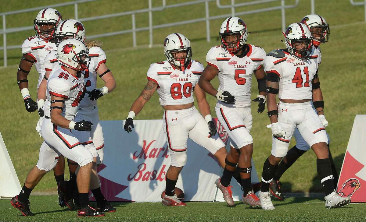 Lamar's Michael Lawson (#41) is surrounded by teammates after running in what they thought was their first touchdown, later recalled in a penalty call, after sprinting away from Mississippi Valley State's defense during their game Saturday at Lamar. Photo taken Saturday, September 7, 2019 Kim Brent/The Enterprise