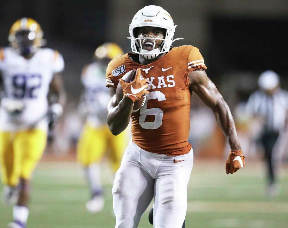 Devin Duvernay gets a straigtaway sprint to the goal line for a fourth quarter touchdown as Texas hosts LSU at Darrell K. Royal Stadium on September 7, 2019. Photo: Tom Reel, Staff / Staff Photographer / 2019 SAN ANTONIO EXPRESS-NEWS