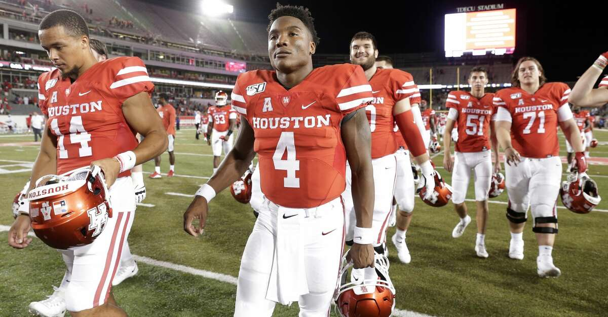 Houston quarterback D'Eriq King (4) leaves the field with his teammates after their NCAA college football game against Prairie View A&M Saturday, Sept. 7, 2019, in Houston, Texas.