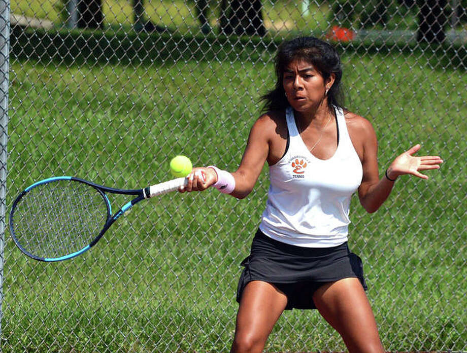 Edwardsville's Chloe Trimpe makes a forehand return during her No. 2 singles match against New Trier 2 on Saturday in the third-place match of the Heather Bradshaw Memorial Invitational. EHS-New Trier 2 tennis at the Heather Bradshaw Memorial Invitational