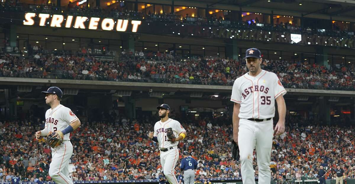 Houston Astros starting pitcher Justin Verlander (35) makes his way back to the dugout after a strikeout in the fifth inning against the Seattle Mariners at Minute Maid Park in Houston on Saturday, Sept. 7, 2019. Houston Astros won the game 2-1.