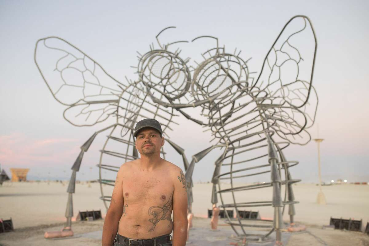 Fabricator Andy Tibbetts in front of Bee Dance, one of the artworks at Burning Man 2019, the largest outdoor arts festival in North America, in the Black Rock desert of Gerlach, Nevada. According to Andy,