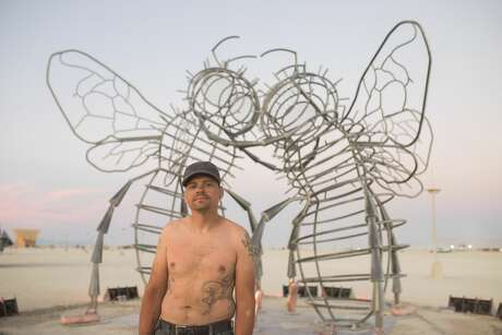 "Fabricator Andy Tibbetts in front of Bee Dance, one of the artworks at  Burning Man 2019, the largest outdoor arts festival in North America, in  the Black Rock desert of Gerlach, Nevada. According to Andy, ""I get to  work with some incredible people; we pull things deep from within our  imaginations, and then place them in the dramatic emptiness of the Black  Rock Desert."" Photo: Jane Hu"