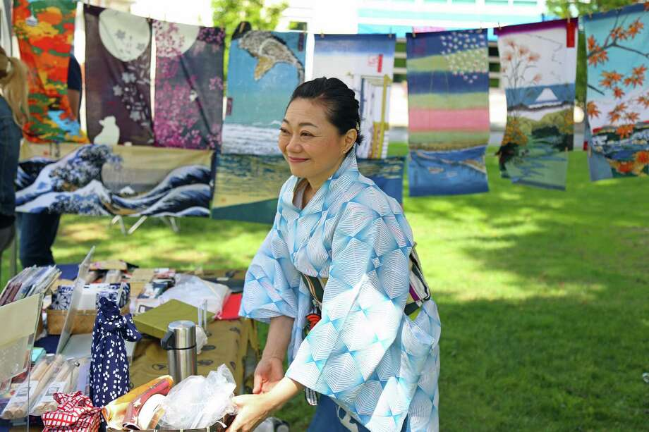 Ruri Kippenbrock of New York City stands among some prints at the Japanese Fall Festival at Jesup Green on Saturday, Sept. 7, 2019, in Westport, Conn. Photo: Jarret Liotta / Jarret Liotta / ©Jarret Liotta