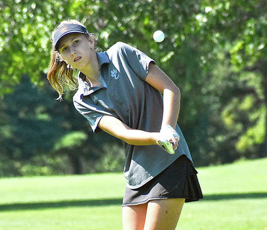 Edwardsville sophomore Grace Daech hits a chip shot onto the green on Hole No. 14 at Rolling Hills Golf Club in Godfrey. Photo: Matt Kamp|The Intelligencer
