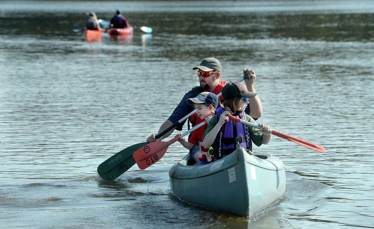 Canoers and kayakers paddle off from the Salt Water Barrier launch site as they join in the Neches River Rally Saturday. Photo taken Saturday, September 7, 2019 Kim Brent/The Enterprise