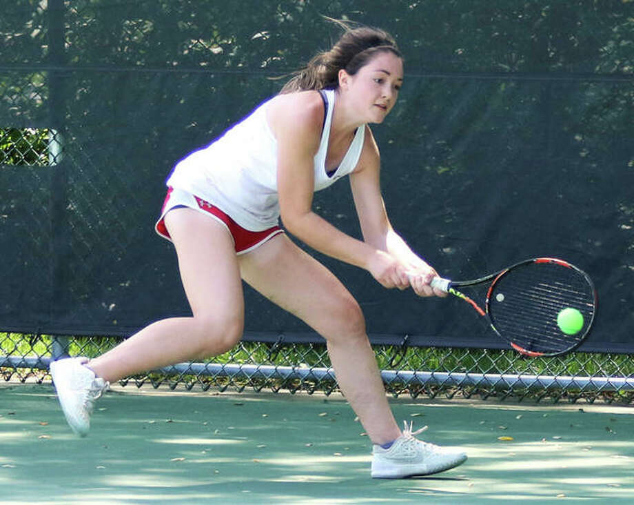 Alton's Maddie Saenz, shown getting to a ball for a backhand earlier this season, went 3-1 to finish fifth at No. 1 singles Saturday at the Springfield SHG Tournament. Photo: Greg Shashack / The Telegraph