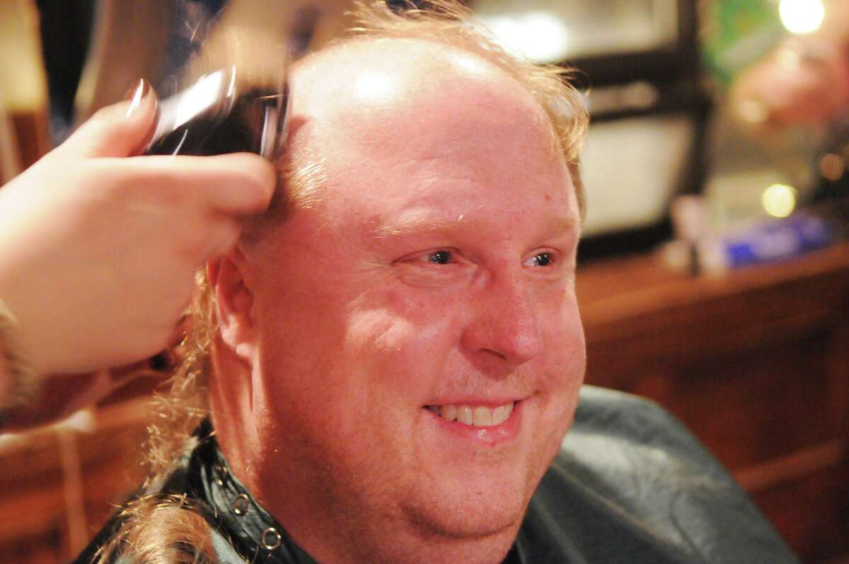 Sean Daly and fellow Stamford Professional Firefighters go bald for kids with cancer as they participate in St. Baldrick's Head Shaving ceremony at Bradford's Grill in Stamford, Conn., March 6, 2014. Daly will receive the Police and Firemen's Insurance Association's Community Service Award during a ceremony at 9 a.m. at the fire department's headquarters.