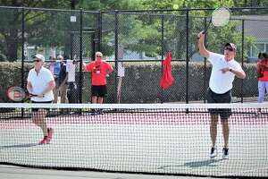 Gov. Ned Lamont showed some country club form on the tennis courts in West Hartford Saturday Sept. 8, 2019 in a tournament for the Connecticut State Employees Campaign for Charitable Giving. He's shown with doubles partner Beth Bye, former state senator, now commissioner for early childhoood.