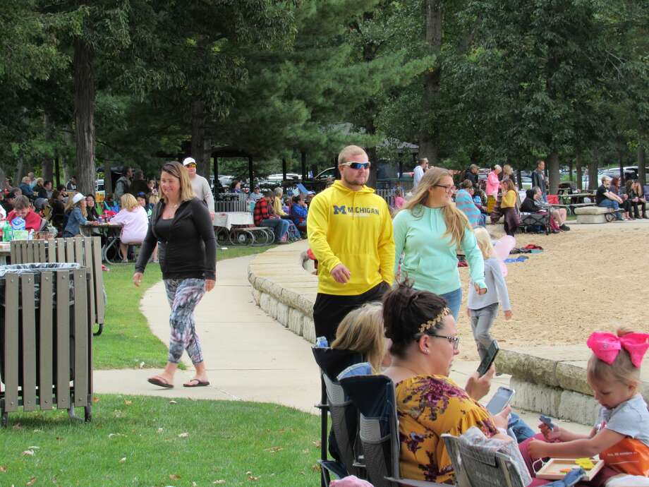 Visitors enjoy food, games and music at Dstreet Music Foundation's 15th annual Parkapalooza festival, Sunday, Sept. 8 at Sanford Lake Park. Photo: (Victoria Ritter/vritter@mdn.net)