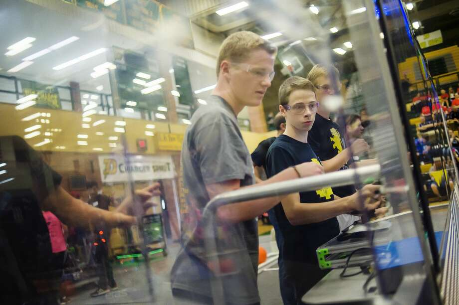 Calvary Baptist's Noah Haines, left, and Aaron Heydenburg, center, compete in a FIRST Robotics event Saturday, Sept. 8, 2019 at H. H. Dow High School. (Katy Kildee/kkildee@mdn.net) Photo: (Katy Kildee/kkildee@mdn.net)