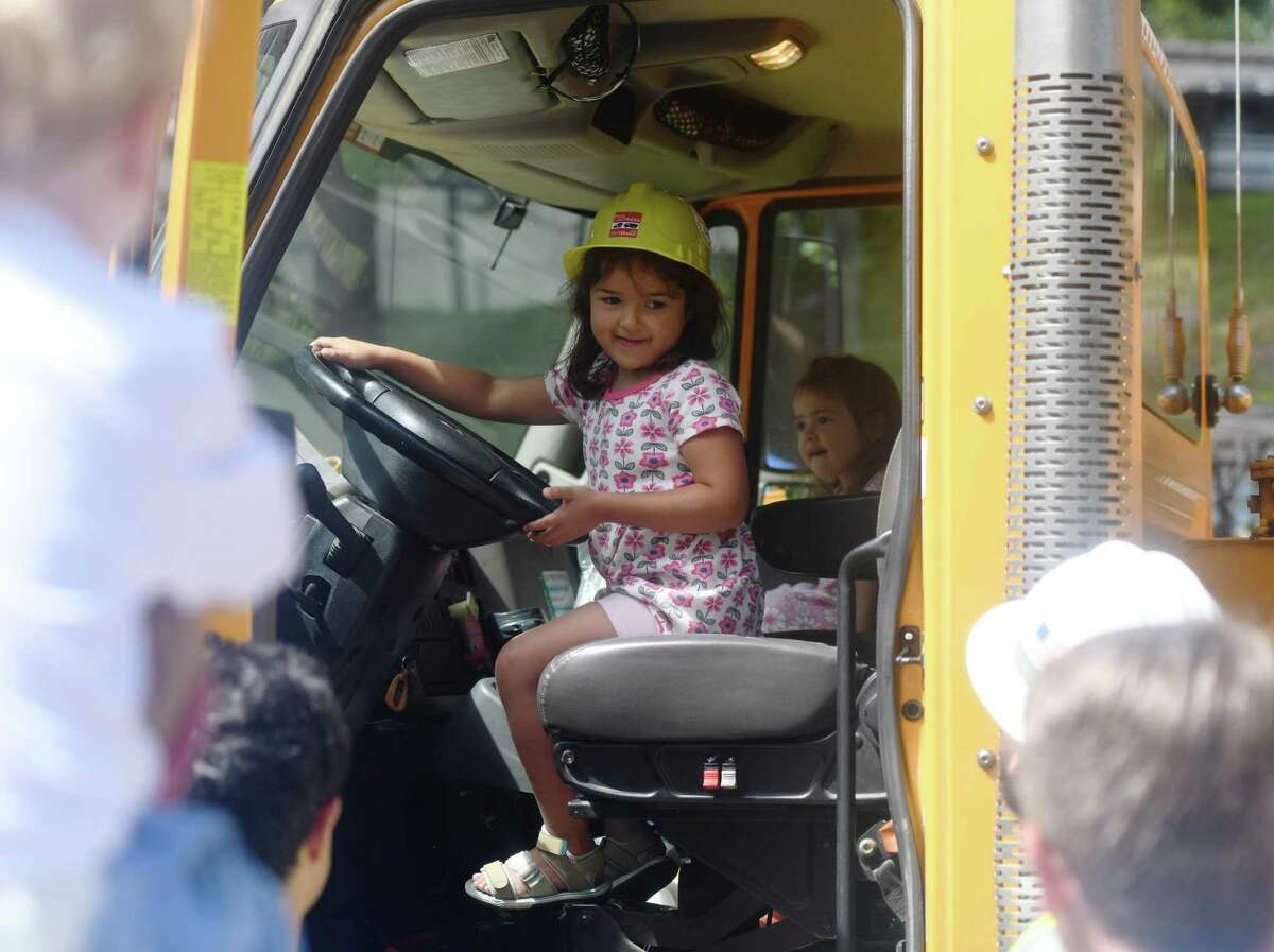 Riverside's Samantha Palhares, 5, sits in the driver's seat of a construction drill truck at the Bruce ConsTRUCKS event at the Bruce Museum in Greenwich, Conn. Sunday, Sept. 8, 2019. The free event celebrated the start of the museum's new renovation and construction project with lots of construction and emergency response vehicles for kids to explore, children's crafts, live music from Songs for Seeds, food trucks, and more. The Bruce also invited attendees to draw or write a note on the gallery walls before renovation work begins.