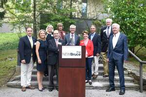 Dignitaries pose during the Bruce ConsTRUCKS event at the Bruce Museum in Greenwich, Conn. Sunday, Sept. 8, 2019. The free event celebrated the start of the museum's new renovation and construction project with lots of construction and emergency response vehicles for kids to explore, children's crafts, live music from Songs for Seeds, food trucks, and more. The Bruce also invited attendees to draw or write a note on the gallery walls before renovation work begins.