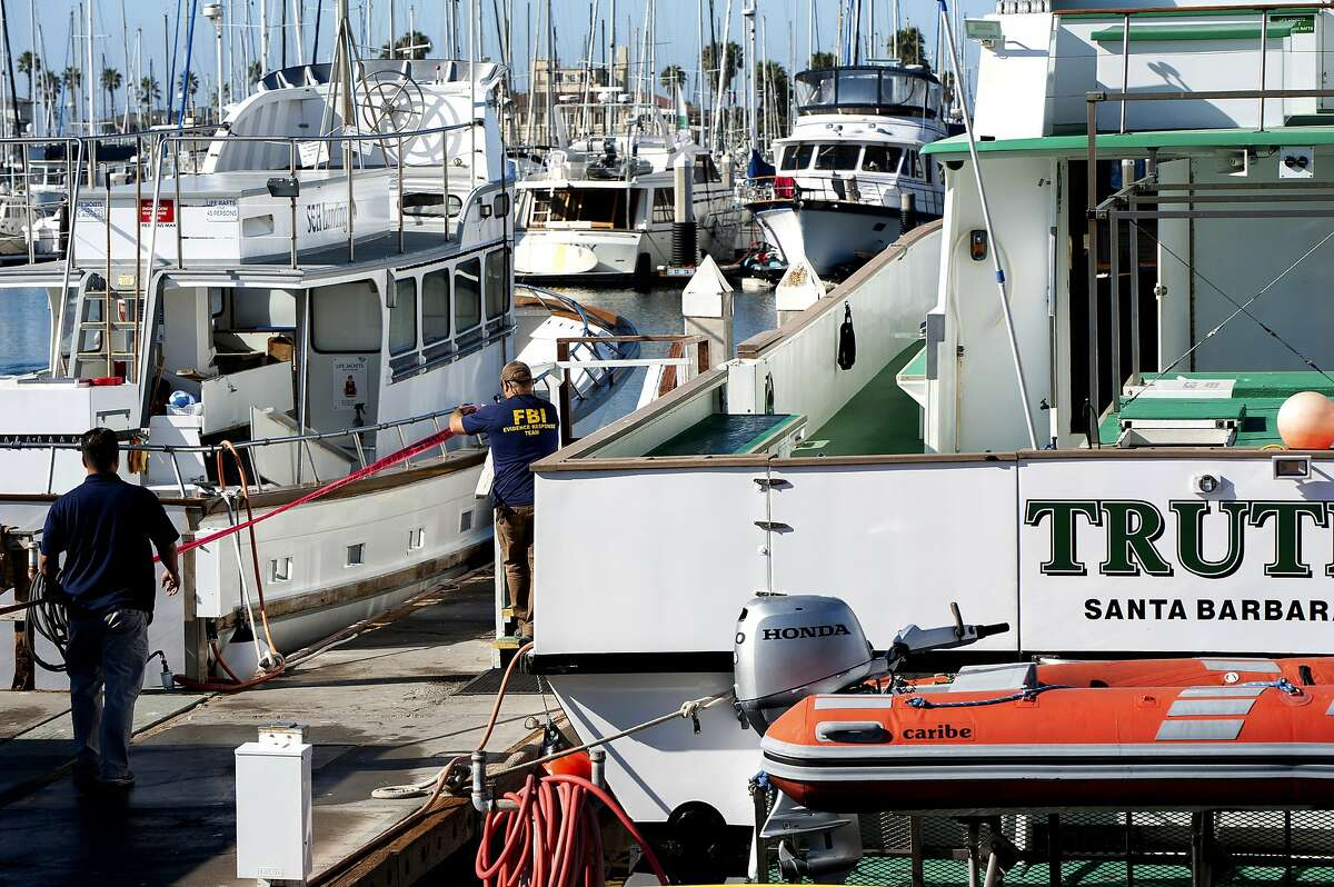Red crime scene tape is placed around the Truth dive boat on the Santa Barbara Harbor as authorities issue a search warrant for the Truth Aquatics' offices in Santa Barbara, Calif., Sunday, Sept. 8, 2019. The California company owned the Conception scuba diving boat that caught fire and killed dozens of people last week. Agents with the FBI, the Bureau of Alcohol, Tobacco, Firearms and Explosives and other agencies also searched the company's two remaining boats. (AP Photo/ Christian Monterrosa)
