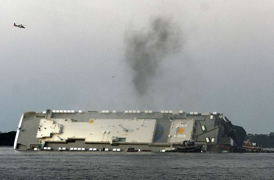 Smoke rises from a cargo ship that capsized in the St. Simons Island, Georgia sound Sunday, Sept. 8, 2019. (Bobby Haven/The Brunswick News via AP) Photo: Bobby Haven / Associated Press