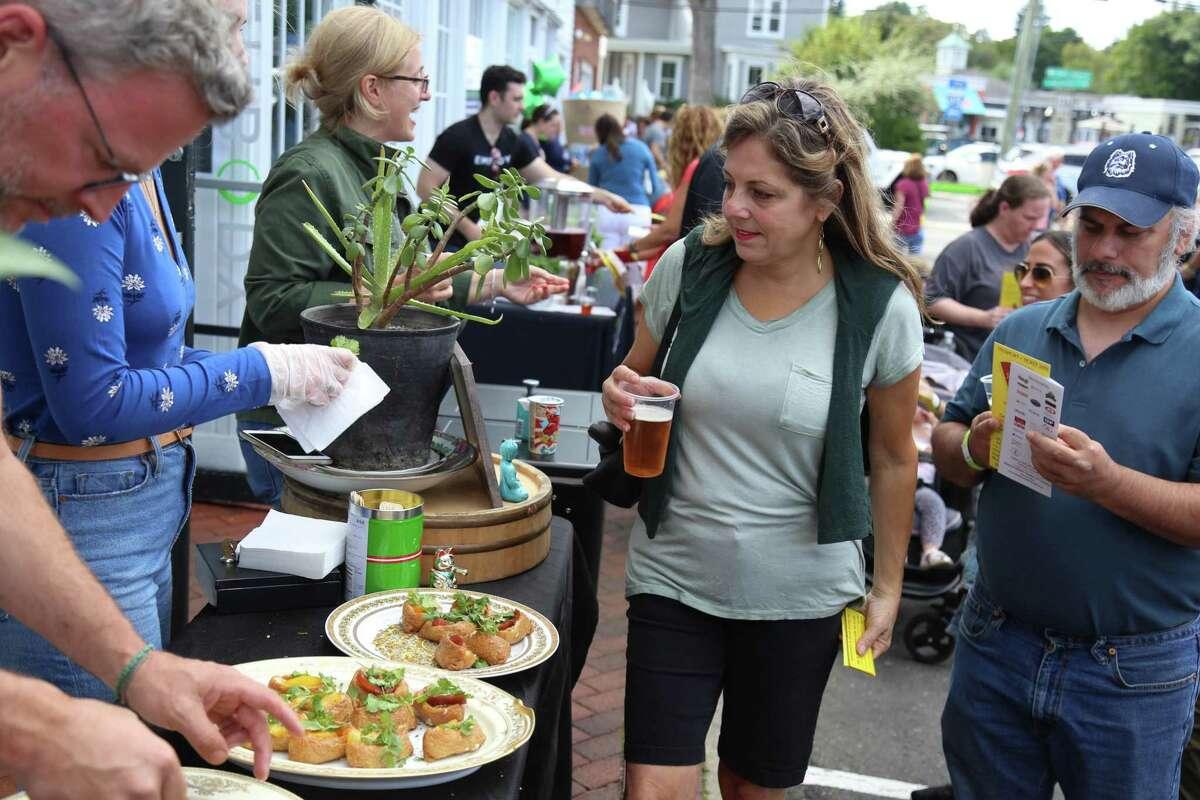 Lisa Pinney-Keusch of Westport and John Dibella of Harwinton enjoy some food at Kawa Ni.
