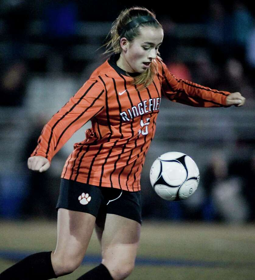 Ridgefield High School's Faith Arnold catches the ball in the Class LL semifinals girls soccer game against Simsbury High School, played at Municipal Stadium in Waterbury. Monday, Nov. 12, 2018 Photo: Scott Mullin / For Hearst Connecticut Media / The News-Times Freelance
