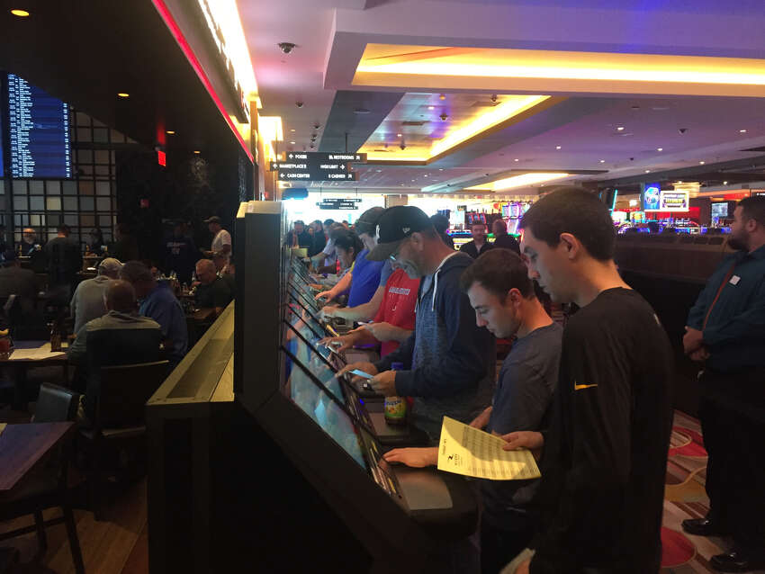 Gamblers place their bets at Rivers Casino and Resort during the opening weekend of NFL football.