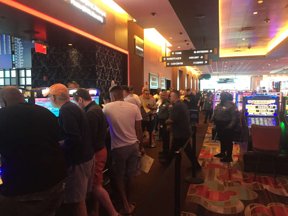Gamblers wait in line to access betting kiosks at Rivers Casino and Resort in Schenectady on Sunday.