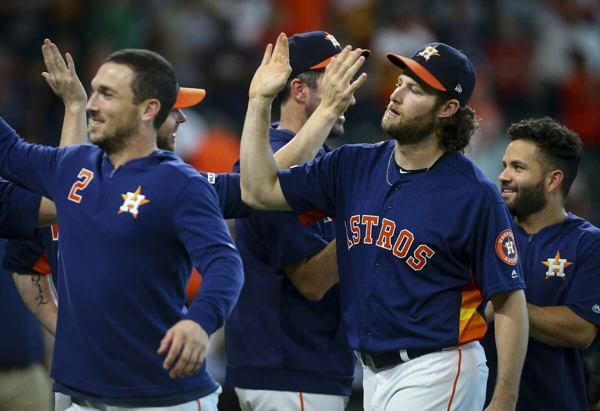 Houston Astros starting pitcher Gerrit Cole (45), right, celebrates with teammates after defeating the Seattle Mariners 21-1 at Minute Maid Park Sunday, Sept. 8, 2019, in Houston. Cole is the second pitcher ever to strike out 14 or more batters in three straight starts.