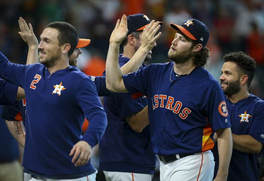 Houston Astros starting pitcher Gerrit Cole (45), right, celebrates with teammates after defeating the Seattle Mariners 21-1 at Minute Maid Park Sunday, Sept. 8, 2019, in Houston. Cole is the second pitcher ever to strike out 14 or more batters in three straight starts. Photo: Godofredo A Vásquez