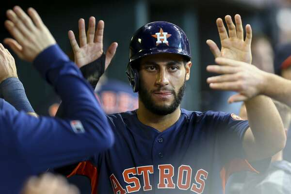 Houston Astros third baseman Abraham Toro (13) celrbaets with teammates in the dugout after scoring against the Seattle Mariners during the eighth inning of an MLB game at Minute Maid Park Sunday, Sept. 8, 2019, in Houston. Toro hit a double to left field in the inning, which broke the team record for doubles, 11, in one game.