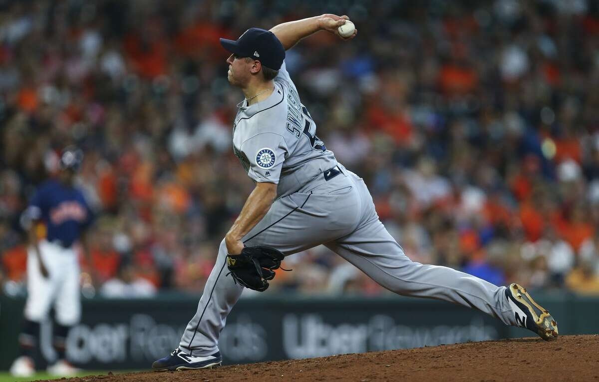 Seattle Mariners starting pitcher Erik Swanson (50) throws against the Houston Astros during the third inning of an MLB game at Minute Maid Park Sunday, Sept. 8, 2019, in Houston. The Astros won 21-1.