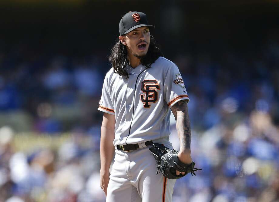 San Francisco Giants starter Dereck Rodriguez reacts during a pitching change during the fifth inning of a baseball game against the Los Angeles Dodgers in Los Angeles, Sunday, Sept. 8, 2019. (AP Photo/Kelvin Kuo) Photo: Kelvin Kuo / Associated Press