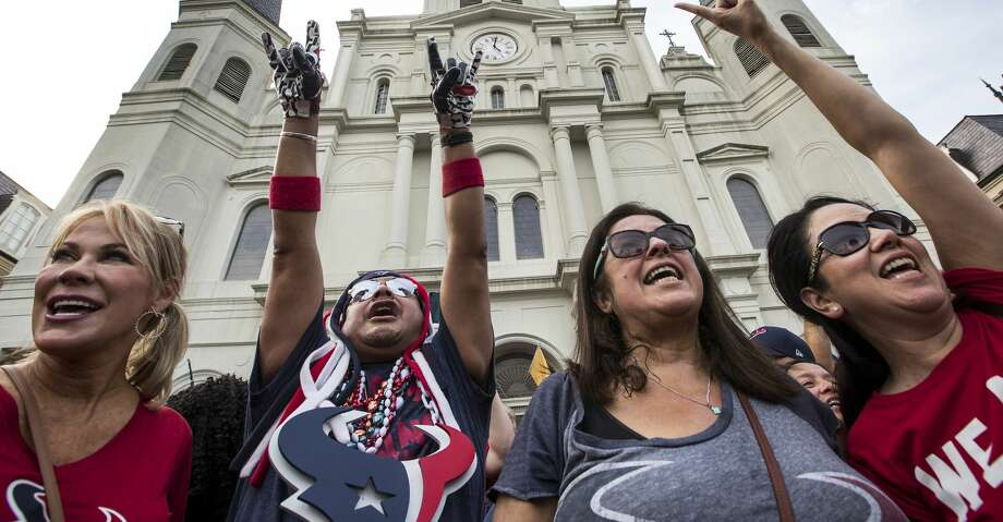 Houston Texans fans Lisa Mitchell, left, Chris Wggin, Tammy Montemayor and Esther Bishop gather for a rally in front of St. Louis Cathedral on Sunday, Sept. 8, 2019, in New Orleans to cheer on the Texans in preparation for the season opener against the New Orleans Saints. The Texans open the 2019 NFL season on Monday Night Football against the Saints in the Mercedes Benz Superdome. Photo: Brett Coomer/Staff Photographer