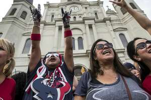 Houston Texans fans Lisa Mitchell, left, Chris Wggin, Tammy Montemayor and Esther Bishop gather for a rally in front of St. Louis Cathedral on Sunday, Sept. 8, 2019, in New Orleans to cheer on the Texans in preparation for the season opener against the New Orleans Saints. The Texans open the 2019 NFL season on Monday Night Football against the Saints in the Mercedes Benz Superdome.