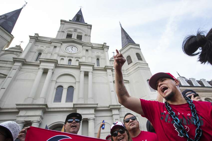 Houston Texans fan Oscar Bravo cheers as he gathers with a few hundred other fans for a rally in front of St. Louis Cathedral on Sunday, Sept. 8, 2019, in New Orleans to cheer on the Texans in preparation for the season opener against the New Orleans Saints. The Texans open the 2019 NFL season on Monday Night Football against the Saints in the Mercedes Benz Superdome.