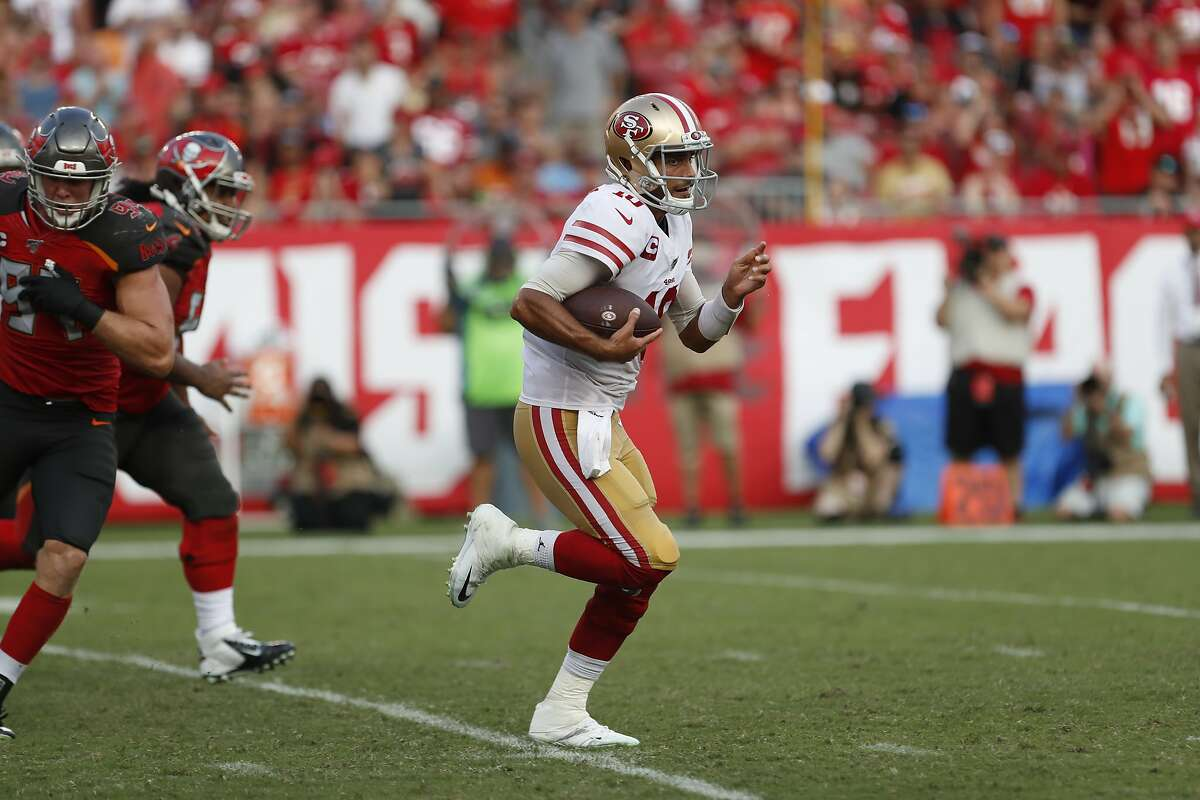 San Francisco 49ers quarterback Jimmy Garoppolo (10) runs out of the pocket against the Tampa Bay Buccaneers during the second half an NFL football game, Sunday, Sept. 8, 2019, in Tampa, Fla. (AP Photo/Mark LoMoglio)