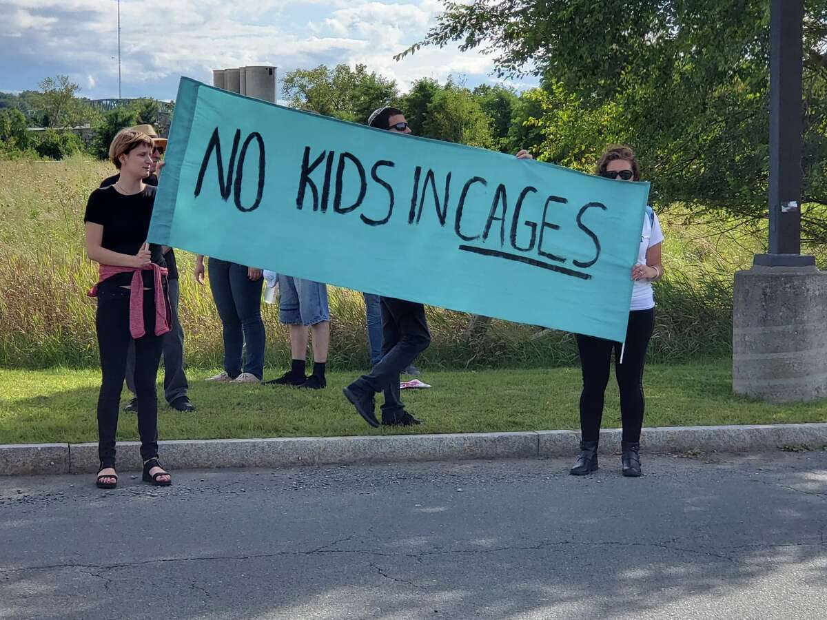 """Hundreds of Jewish activists and allies protest at the Rensselaer County Jail Sunday, Sept. 8, 2019, as part of the national """"Never Again"""" movement in opposition to the U.S. Immigrations and Customs Enforcement's controversial programs. The jail in Troy is the only facility in the state that hands inmates with immigration holds over to ICE. (Brian Houle / Special to the Times Union)"""