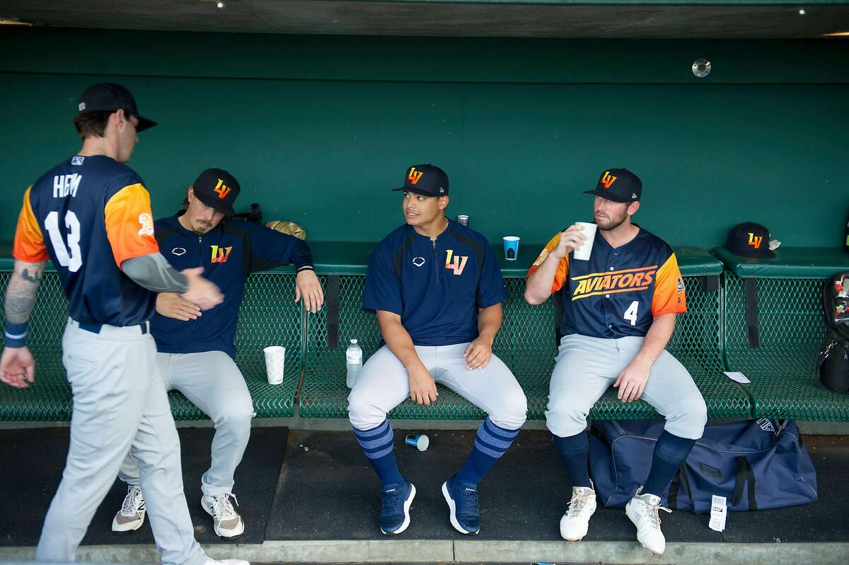 Las Vegas Aviators pitcher Jesus Luzardo, center, visits with teammates during the first Pacific Coast League championship series game against the Sacramento River Cats at Raley Field in Sacramento, Calif. on Wednesday, Sept. 4, 2019.