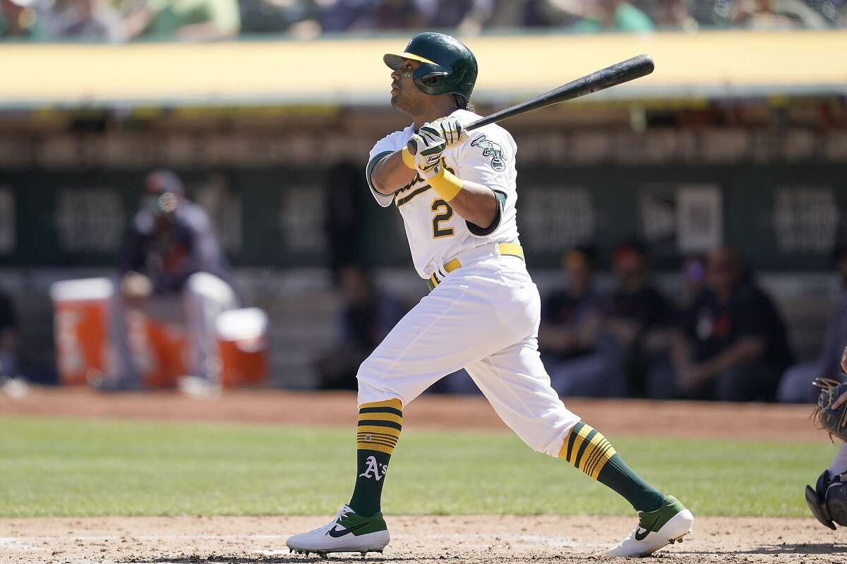 Oakland Athletics' Khris Davis (2) hits a double to drive in two runs against the Detroit Tigers during the fourth inning of a baseball game Sunday, Sept. 8, 2019, in Oakland, Calif. (AP Photo/Tony Avelar)