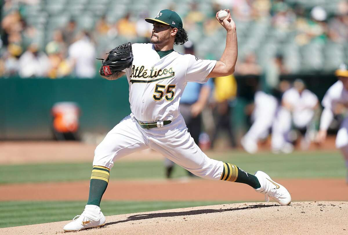 OAKLAND, CALIFORNIA - SEPTEMBER 08: Sean Manaea #55 of the Oakland Athletics pitches against the Detroit Tigers in the top of the first inning at Ring Central Coliseum on September 08, 2019 in Oakland, California. (Photo by Thearon W. Henderson/Getty Images)