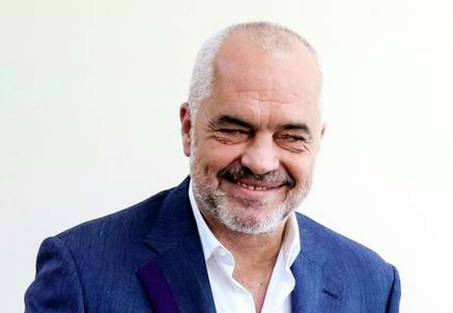 Albania's Prime Minister Edi Rama casts his ballot at a polling station during a municipal elections in the village of Surrel near Tirana on June 30, 2019. - Albanians began casting ballots in tense municipal elections that have become the flashpoint of a democratic crisis, with the opposition boycotting the vote and refusing to recognise its results. (Photo by Gent SHKULLAKU / AFP) (Photo credit should read GENT SHKULLAKU/AFP/Getty Images) Photo: GENT SHKULLAKU / AFP/Getty Images / AFP