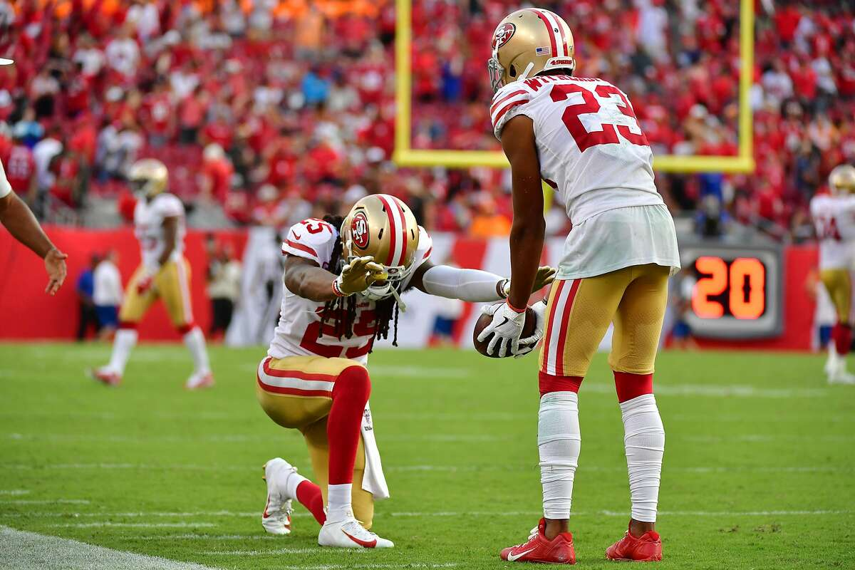 TAMPA, FLORIDA - SEPTEMBER 08: Richard Sherman #25 of the San Francisco 49ers praises Ahkello Witherspoon #23 after Witherspoon scored on an interception thrown by Jameis Winston #3 of the Tampa Bay Buccaneers in the fourth quarter of a game at Raymond James Stadium on September 08, 2019 in Tampa, Florida. (Photo by Julio Aguilar/Getty Images)