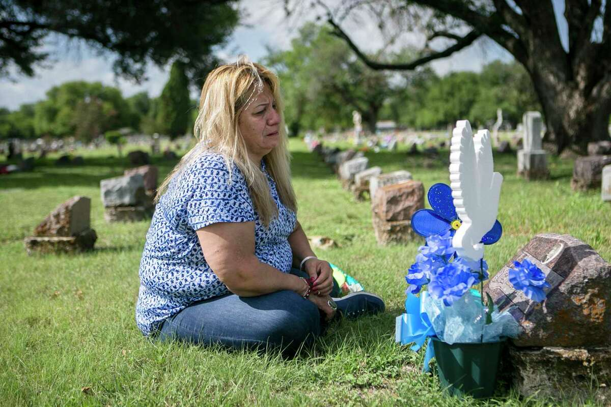 """Rosemary Cantu cries as she visits her daughter Rosemary Vega's grave at San Fernando Cemetery in July 2018. Rosemary Vega died in 1981 when she was 2 years old. Nurse Genene Jones is accused in her death. Cantu visits her daughter's grave every month. """"My heart will never be complete with out her,"""" Cantu says. """"I always wanted a daughter named after me and they took her away from me."""""""